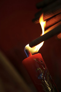 Burning incense sticks on red candle to celebrate the traditional wedding in Chinese