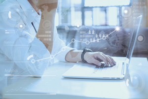Business concept, businessman working laptop.  Global Strategy Virtual Icon.Innovation Graphs Interface. Worldwide connection technology interface.
