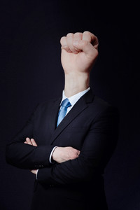 Business consept with a man with a fist head.