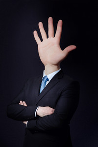 Business consept with a man with a hand as head.