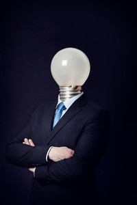 Business consept with a man with a lighting bulb as head. Bright or bad idea.