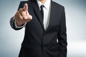 Business man points his finger at you . (focus on hand, blur out the suit).