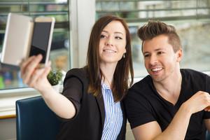 Business People Taking Selfie On Smart Phone