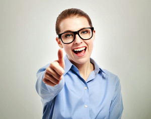 Business woman wearing black eye glasses giving thumbs up or like