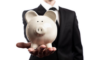 Businessman holding a piggy bank on a white background