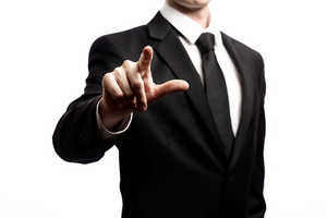 Businessman pointing his finger isolated on a white background