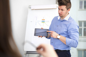 Businessman Showing Digital Tablet To Female Colleague