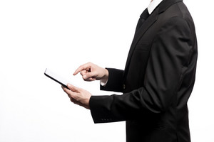 Businessman using a digital tablet isolated on a white background