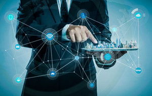 Businessman using digital tablet show the city skyline on virtual screen,smart city and wireless communication network concept .