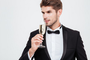 Businessman with champagne looking away. isolated white background