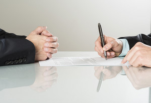 Businessmen are signing a contract, business contract details