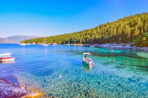 Calm and idyllic Beach of Foki Fiskardo with crystal clear and transparent water, Kefalonia, Ionian islands, Greece