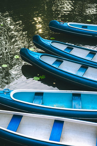 Canoe boats waiting for tourist hire on the lake in municipal city park. Hamburg