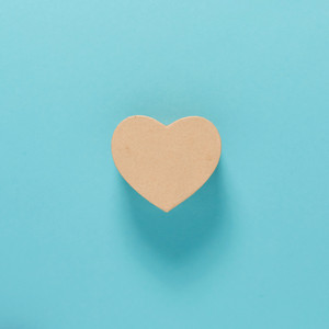 Cardboard heart shaped box on a blue background