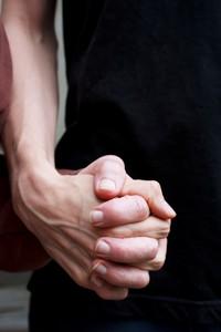 Caregiver holding senior lady's hand outside