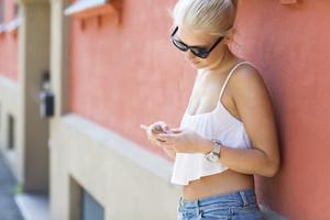 Casual teenage girl using smartphone