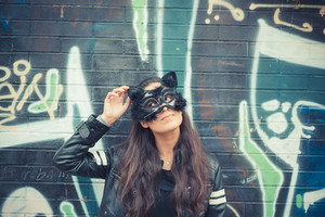 cat mask young beautiful brunette woman in the city