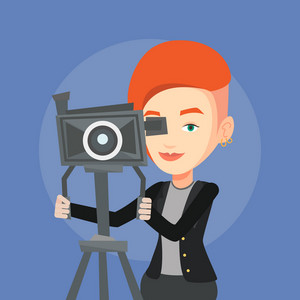 Caucasian cameraman looking through movie camera on a tripod. Young cameraman with professional video camera. Female cameraman taking a video. Vector flat design illustration. Square layout.