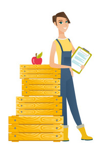 Caucasian farmer holding a clipboard with documents. Full length of young farmer holding documents near crates. Farmer holding documents. Vector flat design illustration isolated on white background.