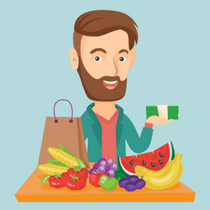 Caucasian male shopper standing at the table with grocery purchases. Young shopper holding money in hand in front of table with grocery purchases. Vector flat design illustration. Square layout.