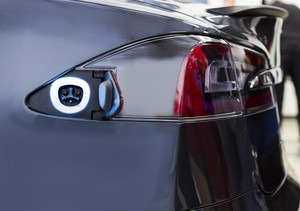 Charging socket on a blue electrically powered vehicle