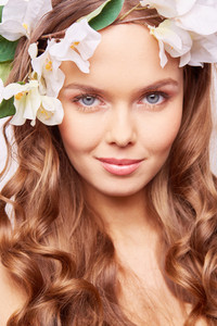 Charming girl with fresh flowers in hair