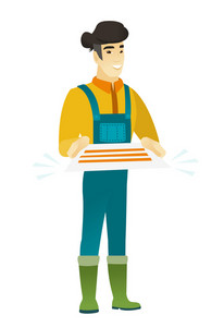 Cheerful asian farmer in coveralls holding a contract. Full length of smiling farmer with a contract. Young farmer holding a contract. Vector flat design illustration isolated on white background.