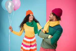 Cheerful young couple with balloons having a date