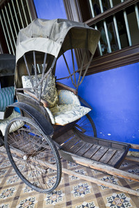 Cheong Fatt Tze's Blue Mansion in Georgetown, Penang, Malaysia. Photo of an old Tuk-Tuk.