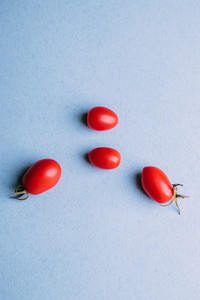 Cherry tomatoes on a blue background, flat view