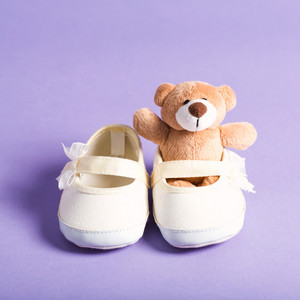 Child celebration theme with a stuffed teddy bear