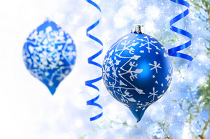 Christmas blue ornaments over bokeh lights background