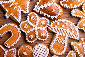 Christmas composition with gingerbreads. Studio shot on wooden background.