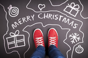 Christmas concept with red shoes and white chalk