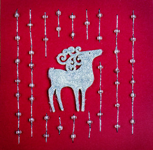 Christmas decoration with reindeer on red background