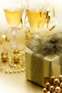 Christmas gift and champagne - Gold colored image