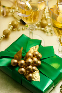 Christmas gift with champagne - Gold and green colored image