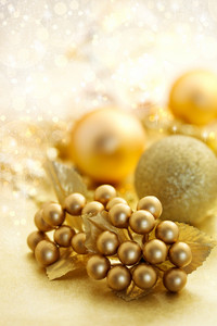 Christmas gold color ornaments over shiny background