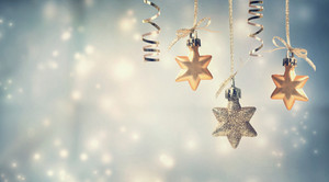 Christmas golden star ornaments in snowy night