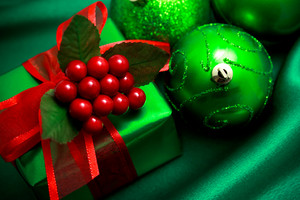 Christmas green gift box with ornaments on silky  cloth