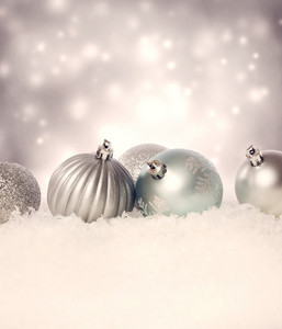 Christmas holiday decoration baubles in a snowing night
