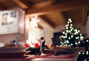 Christmas meal laid on a table in a decorated living room