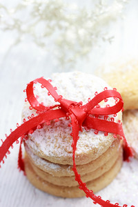 Christmas powdered cookies with red ribbon