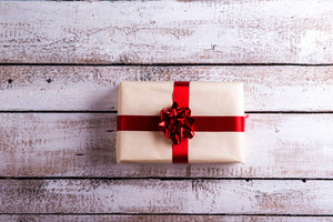 Christmas present laid on a white wooden table background