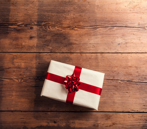 Christmas present laid on a wooden table background