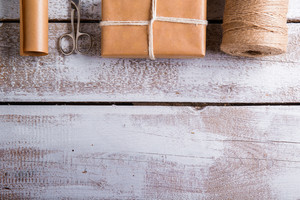 Christmas presents laid on a wooden table background