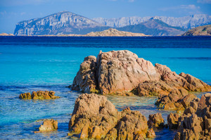 Clear amazing azure coloured sea water on Capriccioli beach with granite rocks, Sardinia, Italy