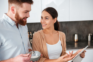 Close up couple in kitchen. woman looking at man