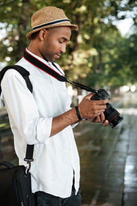 Close up fashion black man in park. with camera