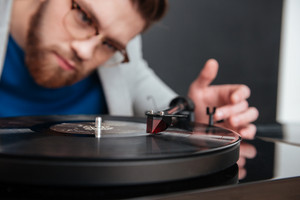 Close up guy with gramophone. cropped image. isolated black background